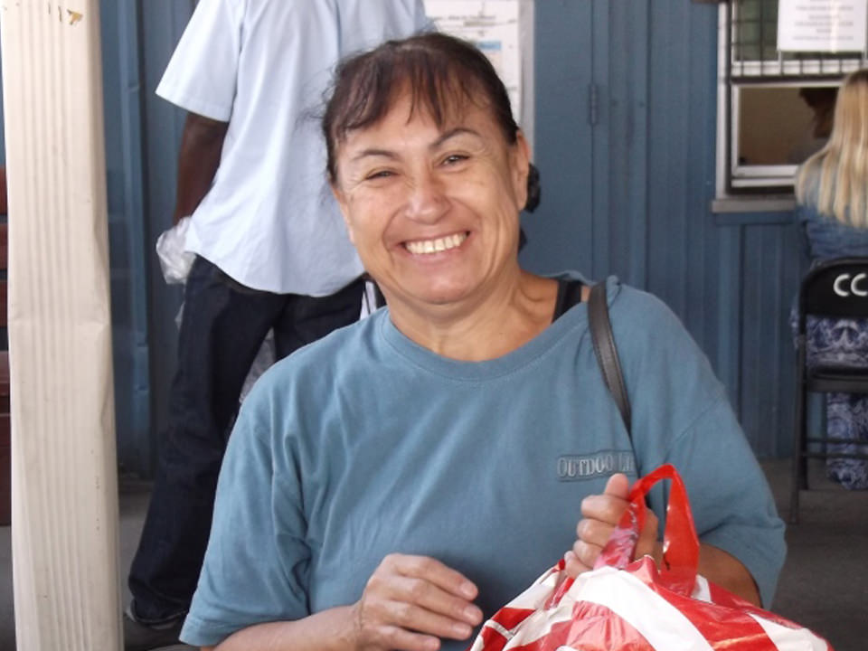 Woman smiling holding bag